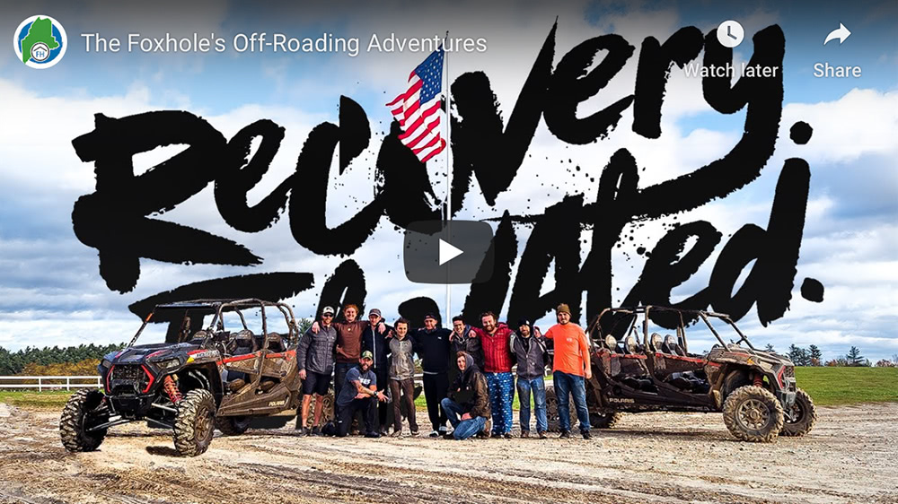 Video cover of Off-Roading Adventures. A group of men in recovery gather around some ATVs.